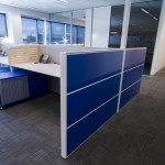 Office desks with blue accents
