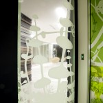Glass panels with greenery design