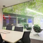 Meeting room with green print on glass panels