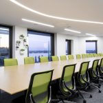 boardroom with green chairs