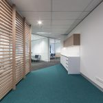 Blue carpeted hallway