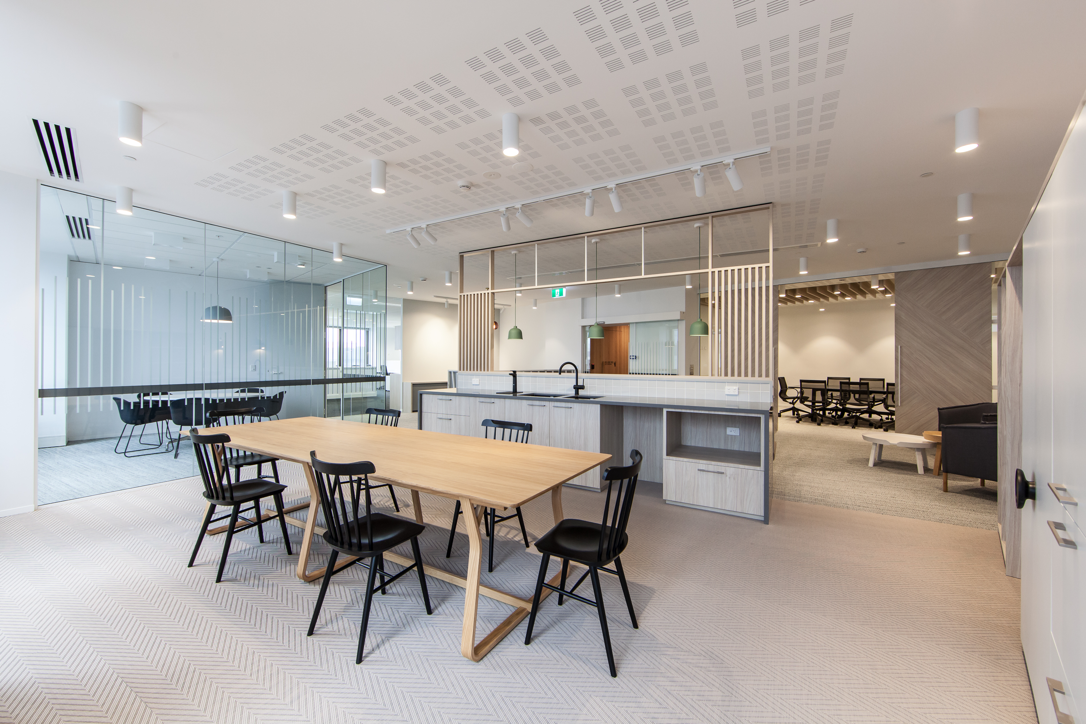 Office kitchen in wood and white tiling