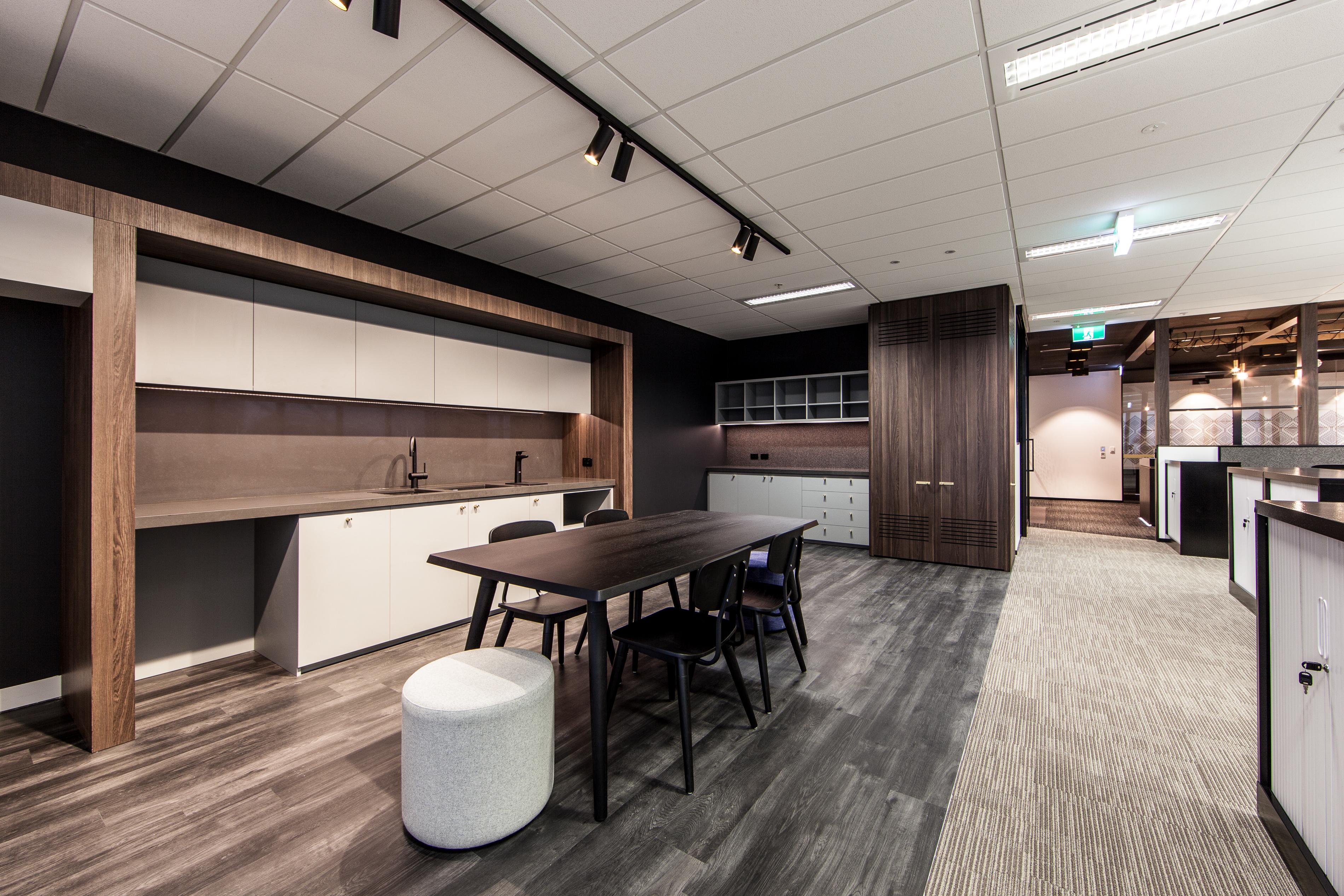 Office kitchen in dark wood