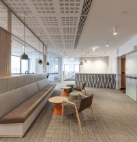 reception area with orange coffee tables